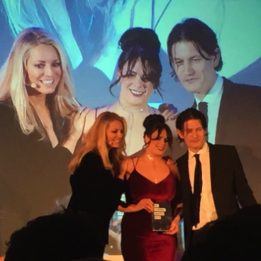 Danielle Kennedy collecting her award from Tess Daly and Marc Zao-Sanders