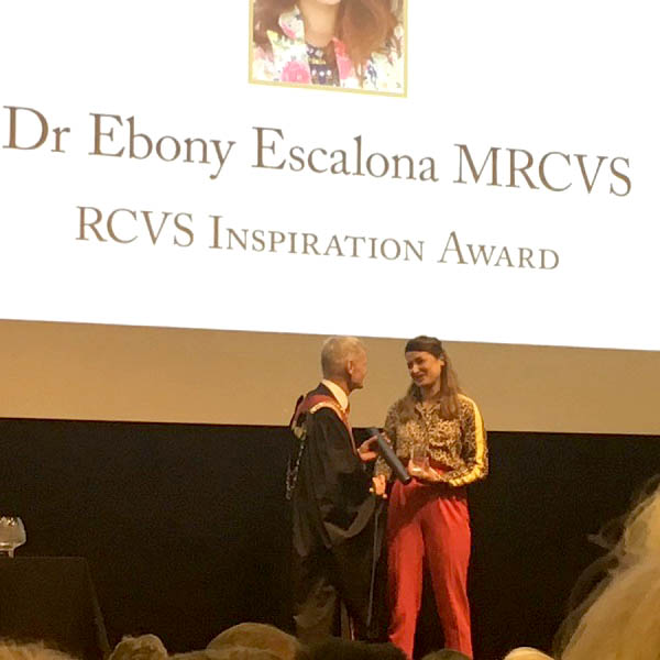 Dr. Ebony Escalona receiving her award from RCVS President, Stephen May