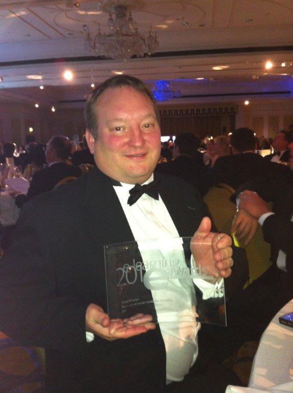 Ron Edwards, Head of Virtual Learning at QA receives the gold eLearning award for best use of social media in learning