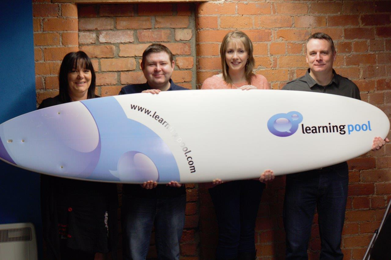 Learning Pool's Patricia Macari, Sean Ward, Aine Bradley  Mark Lynch celebrate Learning Pool's ISO 27001:2009 accreditation.