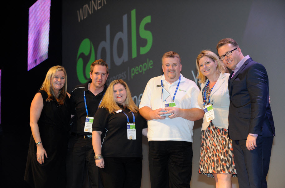 The DDLS Team collect the award from Microsoft's Pip Marlow and Dean Swan