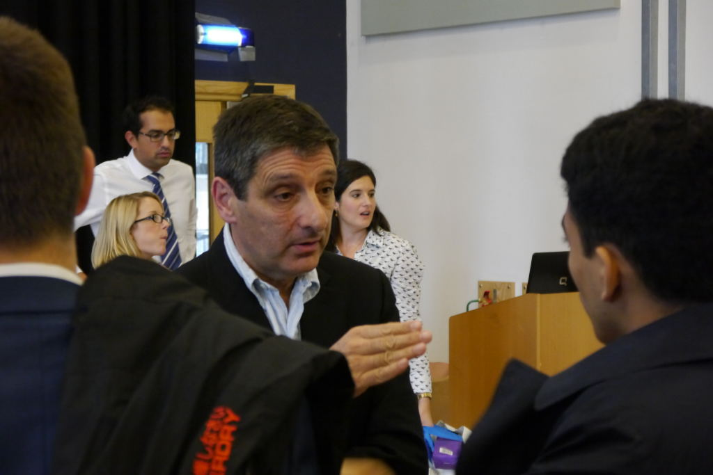 Nick Michaelson discusses entrepreneurship with business studies students in West London.